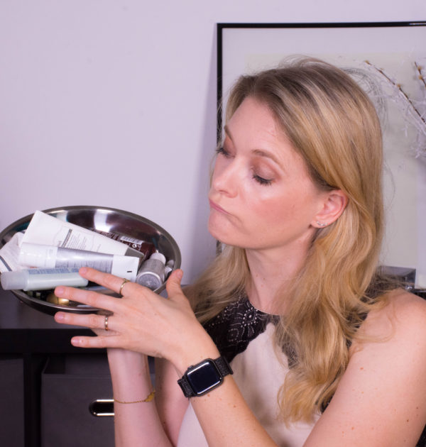 Woman looking at empty beauty products